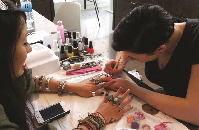 Stefania Flex does nails at CurliQue Beauty, which is within Blanche Macdonald's Atelier Campus Downtown Vancouver.