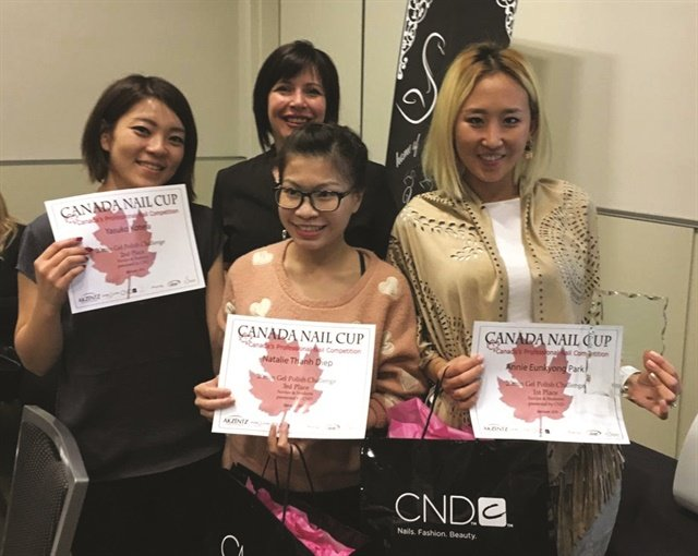Winners of the Canada Nail Cup's CND 20min Gel Polish Challenge show off their certificates.