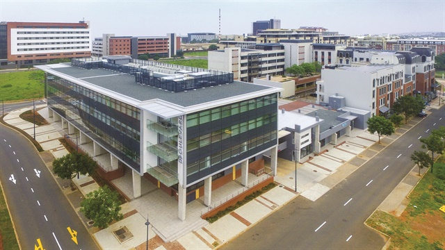 <p>Umhlanga is an affluent commercial and resort town on the coast of South Africa; pictured here is the block that includes the building where Buff Beauty Parlor is housed.</p>