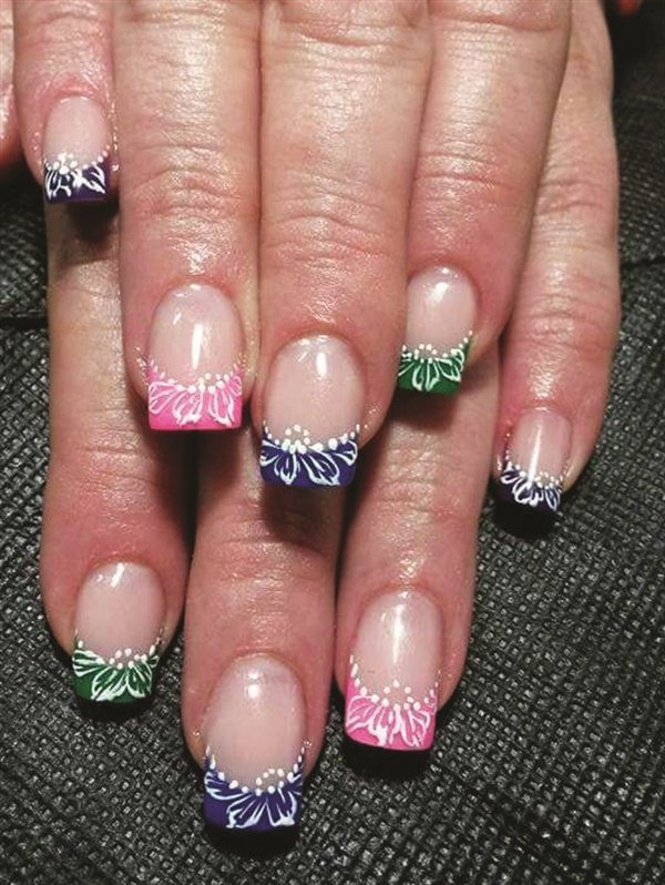 These colorful French nails were created by Elmarie Singleton, who completed a nail art course with E.MI School of Nail Design—Pretoria.