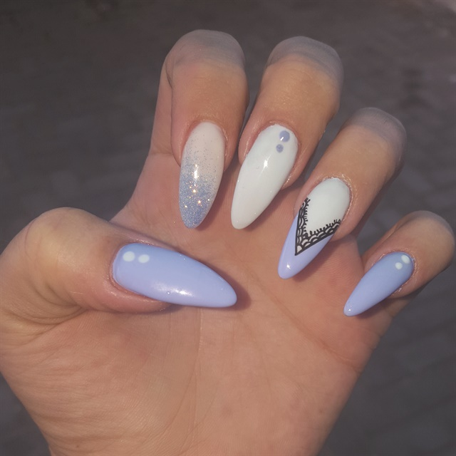 <p>Long almond-shaped nails are popular at Nadia Erasmus's salon.</p>