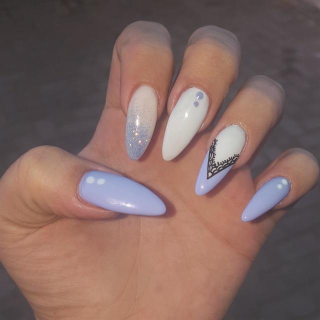 <p>Long almond-shaped nails are popular at Nadia Erasmus's salon.</p>
