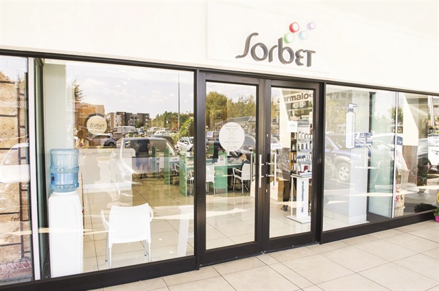 South Africa-based salon chain Sorbet maintains a consistent look with its bubbly logo and signage.