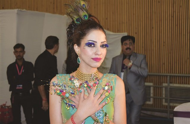 <p>A model shows off a floral fantasy nail design at an AIHBA event.</p>