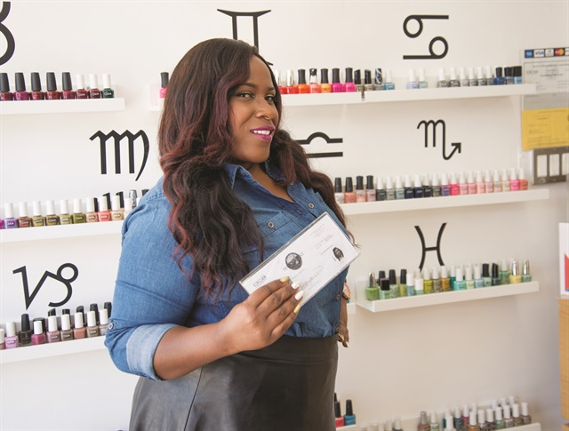 <p>Jackson holds her hard-won California nail tech license.</p>