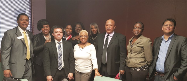 Johnson-Shealey (fourth from left) and other Politics Beauty members and City Council member Jimmy Dickens Sr., who is also a licensed barber (far left), at Beauty Industry Day at the Capitol 2016.