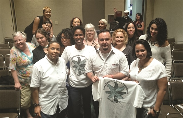 <p>Johnson-Shealey (front row, second from left) also founded The Concerned Beauty Professionals, which provides nail tech continuing education.</p>