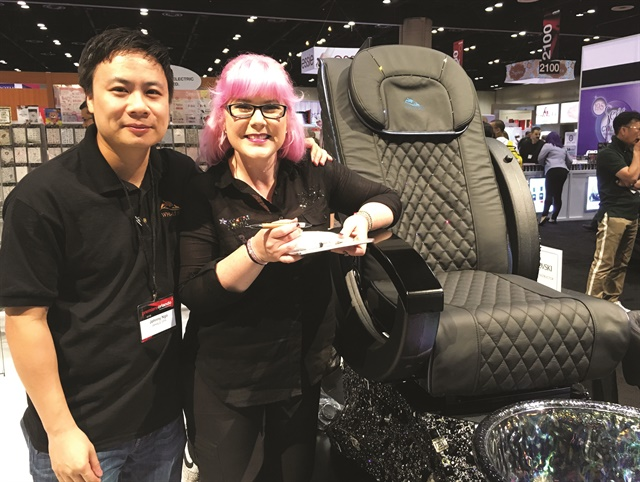 Whale Spa's Johnny Ngo poses with Kellie DeFries.