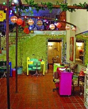 <p>The spa and salon both feature exotic locale-themed treatment rooms. Bright colors, wall treatments, and decor set the mood.</p>