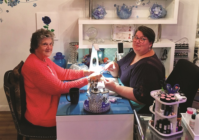 <p>Client Carol enjoys a manicure at Z-Hills, where acrylics are not offered because the odor may irritate clients with respiratory disorders.</p>