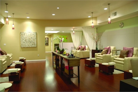 <p>White recliners and curtains lend a serene and clean feel to San Francisco's ZaZa Nail Spa.</p>