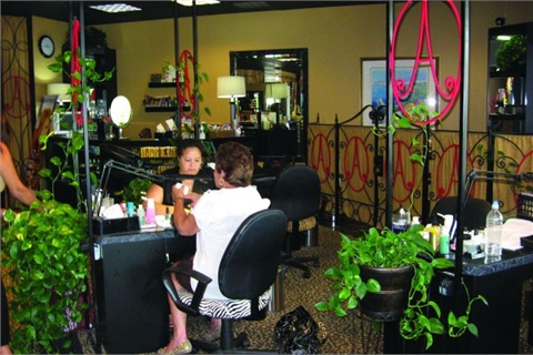 <p>Ava's Spa & Boutique sets the tone with a mix of warm gold and black with just a spash accent of red.</p>