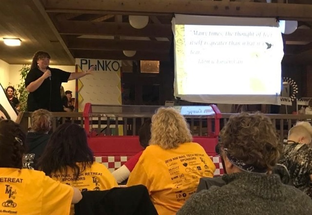 <p>Holly gives a presentation on knowing your value and making sure your salon pricing is right at the 2016 NW Nail Tech Retreat.</p>