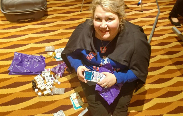 <p>An attendee inspects her purchases after learning some new design ideas.</p>