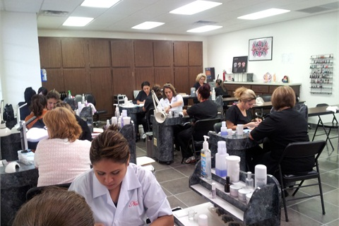 San Antonio Sr. Nail Instructor Gracie King's students participate in a timed test to narrow down their current work time closer to that of a reasonable salon time.