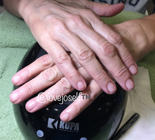 This client had damaged nails so I started her with a restoration.