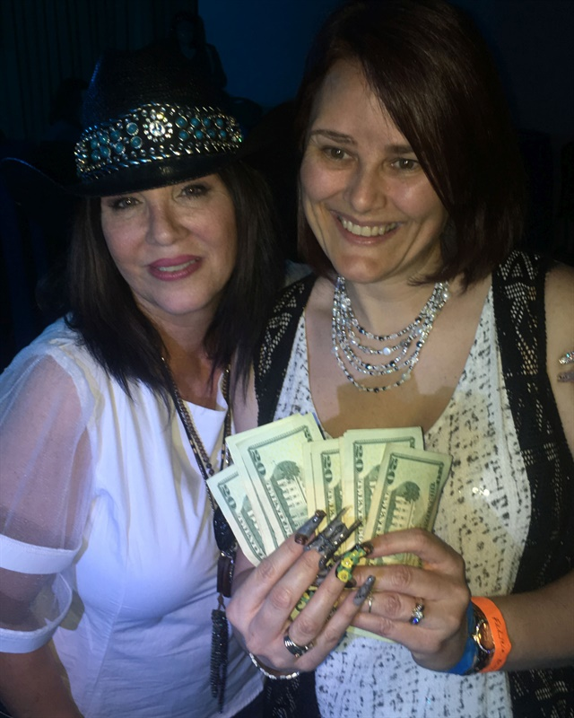 Felicia Minney of Serenity Escape in Eastland, Texas, took home cash for her boot-inspired nails.