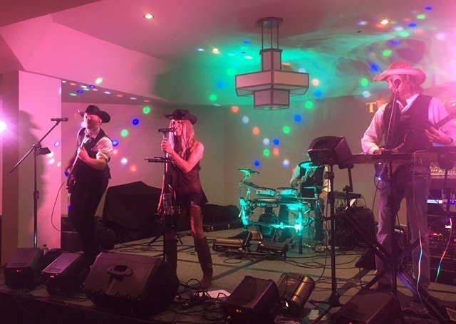 <p>The Boot Scootin' Boogie featured a live band, The Grooves, that covered a wide variety of music.</p>