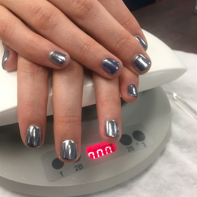 <p>Two editors got to try their first chrome manicure.</p>
