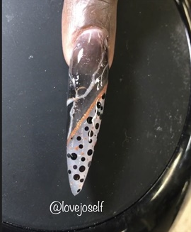 <p>My client let me give her a super long sculpted stiletto and paint custom art. I thought the outcome was great!</p>
