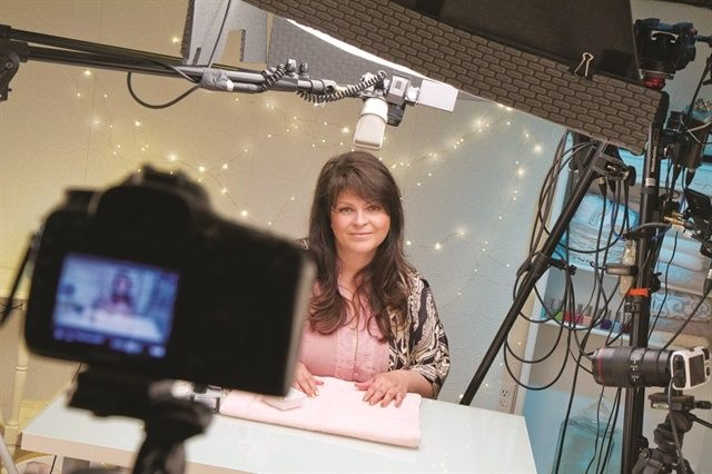 "Suzie Moskal is pictured ""on set"" recording a YouTube nail video."