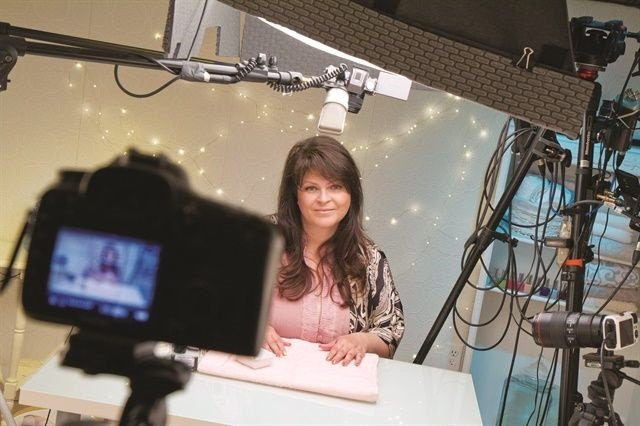 "<p>Suzie Moskal is pictured ""on set"" recording a YouTube nail video.</p>"