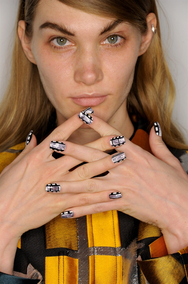Decoupaged film-inspired nails for Opening Ceremony.