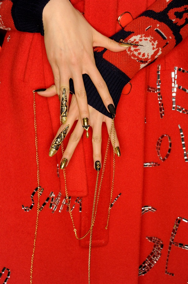 <p>Libertine's elaborate chandelier and shark tooth nails.</p>