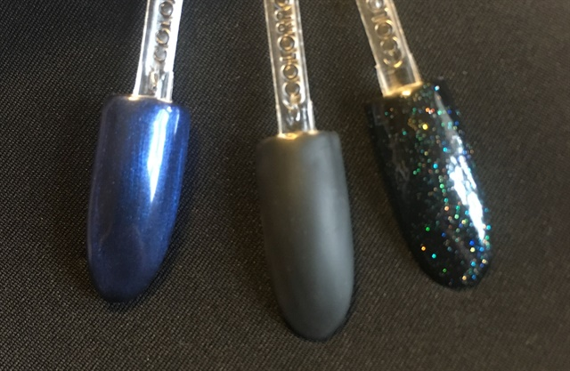 <p>Alluring CND top coats from #thenailscapebox seen over black: Pearl, Matte, and Glitter.</p>