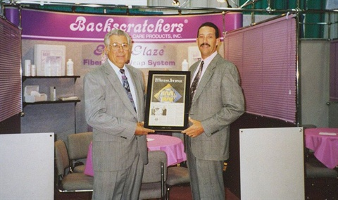 <p>In 1994, Jack Megna (left) and son Michael promoted their fiberglass products to wary tradeshow attendees.</p>