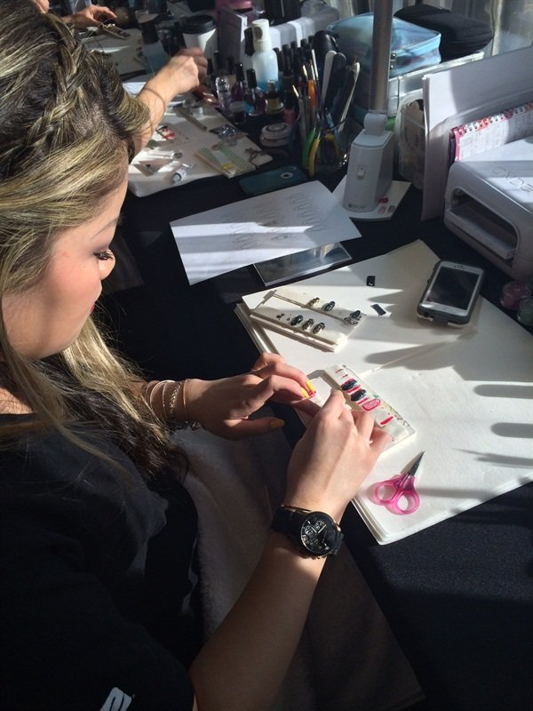 <p>CND Education Ambassador Michele Huynh preps custom nail designs for TheBlonds NYFW runway show in the CND Design Lab.</p>