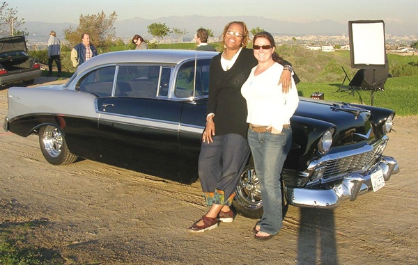 Maisie and NAILS executive editor Hannah Lee chill out by the classic 1956Chevy BelAir used for the photo. shoot.