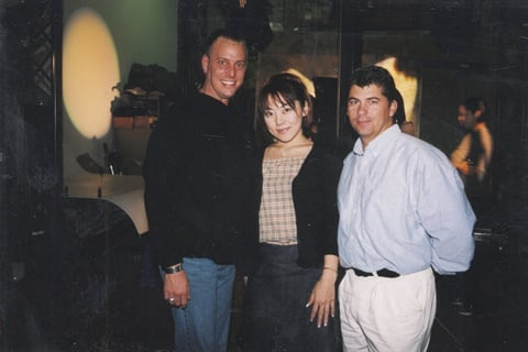 Behind the scenes for a cover photo shoot for NAILS Magazine in March 2000, Tom joins Danny Haile (of EZ Flow, at the time) and Eriko Kurosaki.