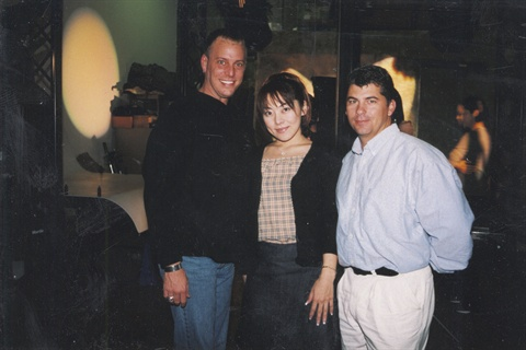 <p>Behind the scenes for a cover photo shoot for NAILS Magazine in March 2000, Tom joins Danny Haile (of EZ Flow, at the time) and Eriko Kurosaki.</p>