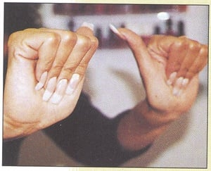 <p>Make a straight fist by bending the first knuckles of your fingers and touching the pads of you fingers to the base of your palm.</p>