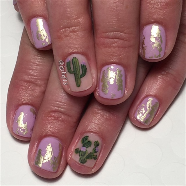 "<p><a href=""http://nailartgallery.nailsmag.com/jgchef13/photo/475970/cactus-cuteness-gel-manicure"">Via Nail Art Gallery</a></p>"