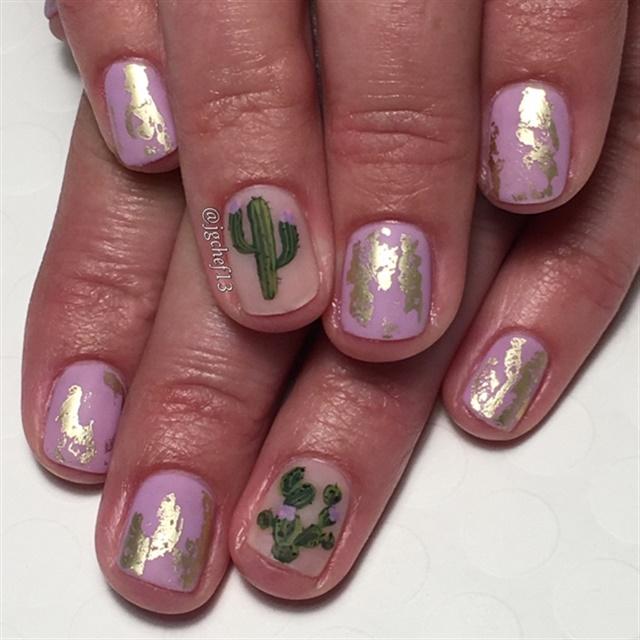 "<p><a href=""http://nailartgallery.nailsmag.com/jgchef13/photo/475970/cactus-cuteness-gel-manicure"">Via Nail Art Gallery</a></p>"