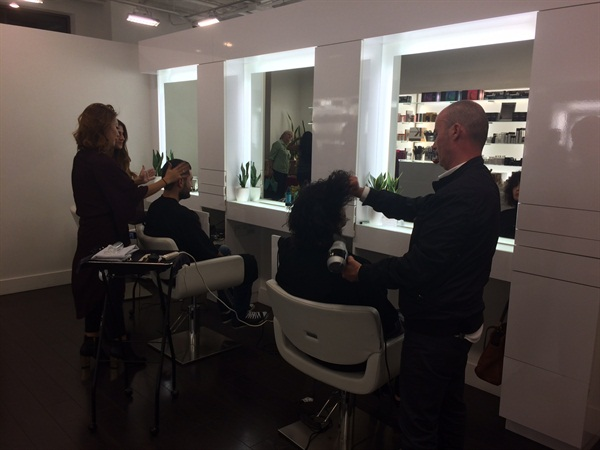 The salon is known for its hair services, which were part of the holiday soiree offerings.
