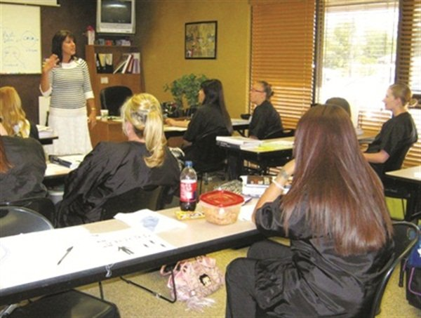 Color My Nails School of Nail Technology brings in guest speakers, such as this woman who is sharing information on body language and how to build your nail business, and invites both current students and alumni to these continuing education classes.
