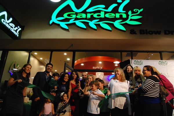 The official green ribbon cutting for the grand opening of the Nail Garden's seventh location.