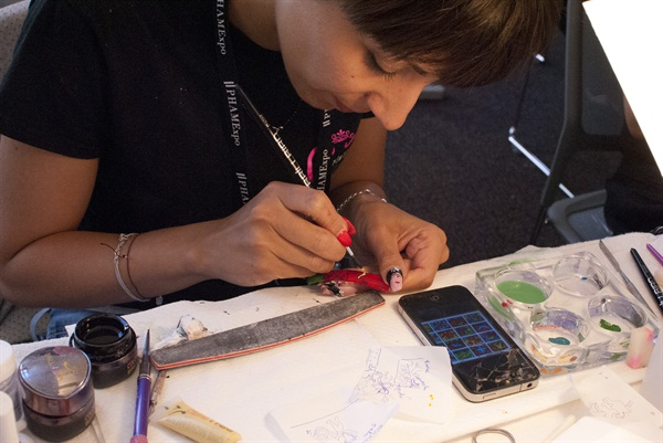 Lucia Tursi sketched first then began painting her nail tip.