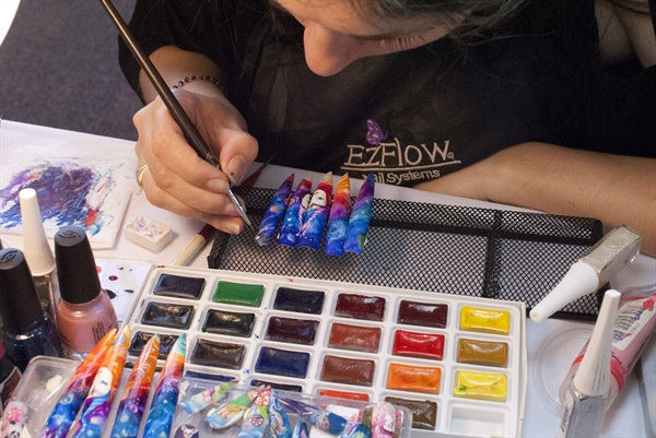 <p>Virginia Arleo adding details to her design.</p>