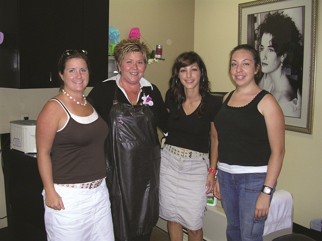 <p>Executive editor Hannah Lee (left) and I (far right) thoroughly enjoyed our pedicures from Ellen Zimba andMichelle McLeod.</p>