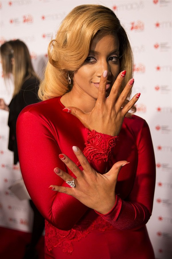 Nail art fan Dascha Polanco in her Jamberry wraps and red dress.