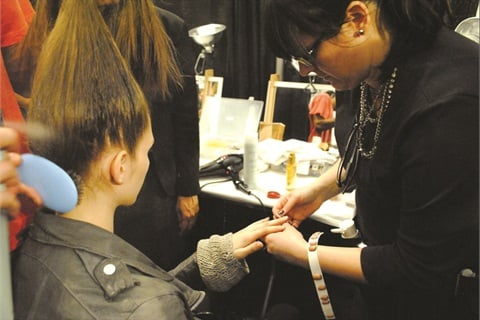CND education ambassador Heather Reynosa-Davis does backstage manis and pedis at New York Fashion Week.
