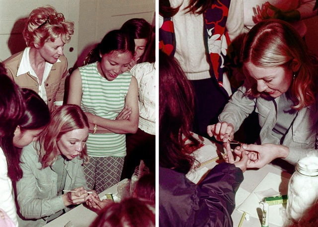 "Tippi Hedren observes as Dusty Coots Butera instructs the ""Original 20"" Vietnamese women in the nail industry on how to create the Juliette wrap. They were eager to learn how to do nails. (Photos by Massimo Butera)"