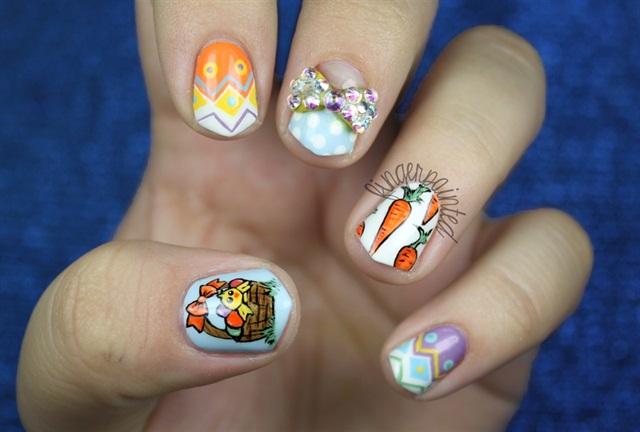 "<p>Via <a href=""http://nailartgallery.nailsmag.com/leximartone/photo/321770/easter-bunny-egg-nails"">Nail Art Gallery</a></p>"