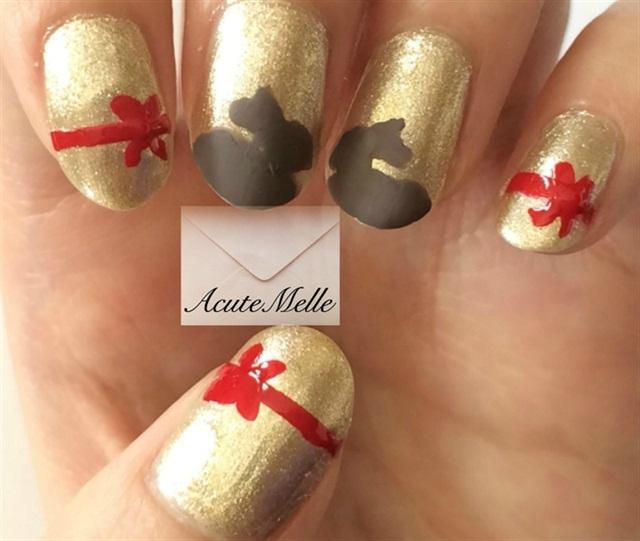 "<p>Via <a href=""http://nailartgallery.nailsmag.com/acutemelle/photo/401198/lindt-chocolate-bunny-nail-art"">Nail Art Gallery</a></p>"