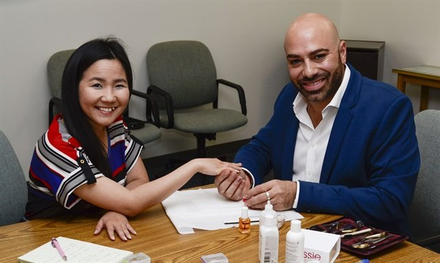 <p>Essie's Gino Trunzo (right) treated VietSALON managing editor Anh Tran and me to a manicure using Essie's new nail treatments.</p>