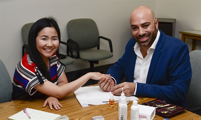 Essie's Gino Trunzo (right) treated VietSALON managing editor Anh Tran and me to a manicure using Essie's new nail treatments.